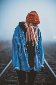 cold,  weather,  foggy,  fog,  moody,  mood,  girl,  blonde,  woman,  standing,  person,  portrait,  people,  beanie,  train tracks,  trains,  train,  tracks