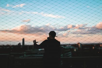 chainlink, fence, sunset, sky, clouds, guy, man, people, shadow, silhouette, city, urban