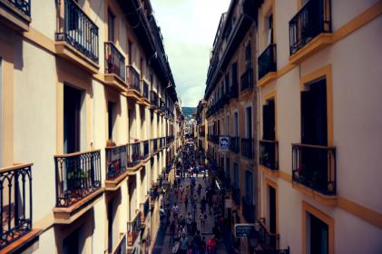 houses, apartments, town, city, balconies, balcony, windows, street, people, crowd, walking, pedestrians