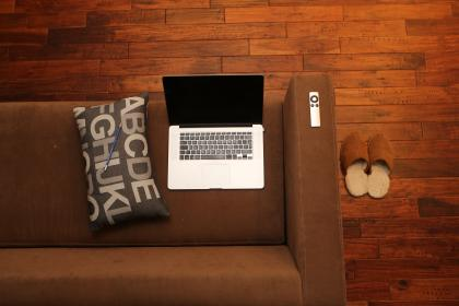 macbook, laptop, apple, remote, sofa, couch, pillow, pencil, slippers, hardwood, floors, condo, loft, apartment