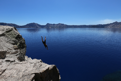 man,  diving,  lake,  water,  cold,  cliff,  blue sky,  clear,  still,  calm,  adventure,  brave