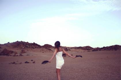young, girl, woman, long hair, brunette, people, white, shorts, tank top, feathers, desert, rocks, sky, beauty