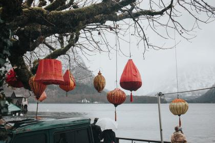 trees, lake, branches, lantern, umbrella, people, view, park, vehicle, mountains, landscape, snow, winter, houses