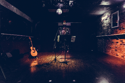 musician,  guitar,  singer,  songwriter,  bar,  dive bar,  microphone,  disco ball,  brick, nightlife, club