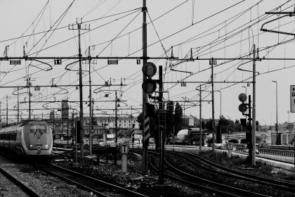 black and white, train tranks, trains, railroad, railway, power lines, signs, transportation