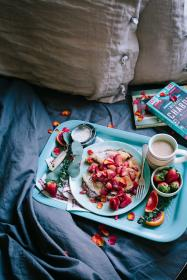 breakfast, pancake, strawberries, tray, flour, bed, pillow books, cup, coffee, fork, bowl, blanket, leaves, flowers