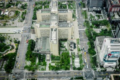 city, aerial, view, green, grass, garden, trees, plants, building, structure, architecture, rooftop, park, pedestrians, car, vehicle, truck, taxi, road, street, billboard