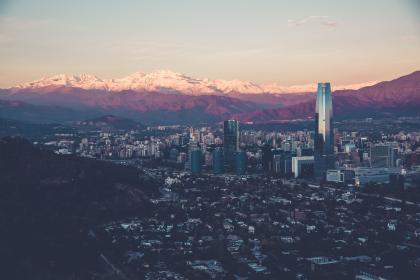 city, houses, buildings, architecture, view, mountains, peaks, sky, sunset, skyscrapers, high rises, cityscape, landscape