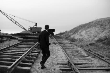 guy, man, suit, railway, railroad, train tracks, sand, crane, black and white, people