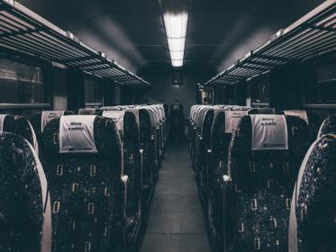 bus, train, transportation, seats, aisle, night, evening, lights