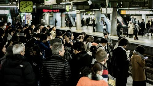people, men, women, children, family, friend, waiting, train, station, japan, travel, trip, transportation, vacation, signage, clock, time, railway, subway, security, camera, safety, cellphone, gadgets, electronics, technology, modern, city, urban