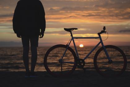 guy, man, male, people, back, contemplate, stand, bicycle, ride, beach, shore, sand, water, ocean, sea, sky, clouds, horizon, sun, dusk, dawn, sunrise, sunset, light, shadows, silhouette