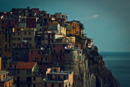sky, houses, residences, apartments, windows, shutters, mountain, hill, city, town, rooftops, ocean, water, view