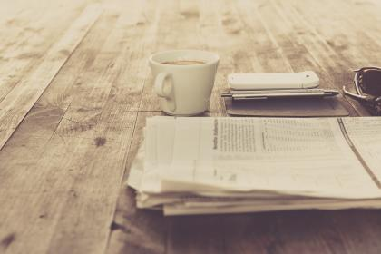 still, items, things, journal, planner, pen, morning, broadsheets, newspapers, news, sunglasses, mobile, phone, wood, table, bokeh, outdoors, mug, cup, coffee