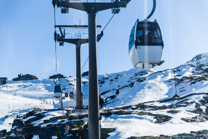 cable car,  snow,  mountain,  cold,  ice,  high,  blue,  sky,  ski,  sport,  travel,  adventure