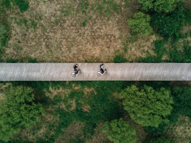 green, trees, plant, nature, field, bridge, infrastructure, road, trip, people, riding, bike, travel, aerial, view