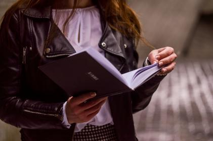 people, girl, female, woman, reading, book, knowledge, study, education, leather, jacket, clothing
