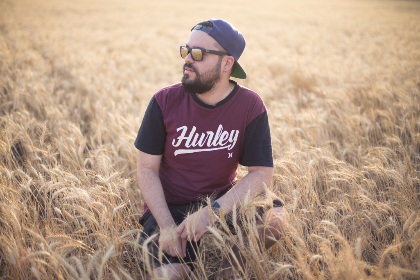 man,  sitting,  field,  sunglasses,  people,  hat,  cap,  baseball cap,  beard,  wheat,  farm,  farmland