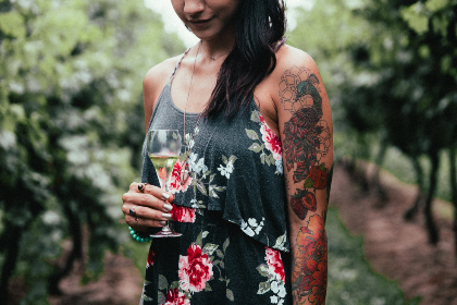 woman,  wine,  vineyard,  person,  female,  nature,  outdoors,  drink,  alcohol,  beverage,  thirst,  tattoos,  jewelry,  smiling,  leisure,  relaxing,  enjoyment