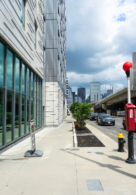 empty,  city,  street,  corner,  road,  cars,  sidewalk,  curb,  autos,  shopping,  sign,  hydrant,  urban,  buildings,  sky,  clouds