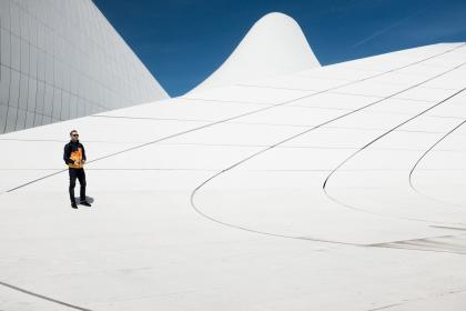 people, man, alone, shadow, shades, sunglasses, architecture, roof top, building, establishment, white
