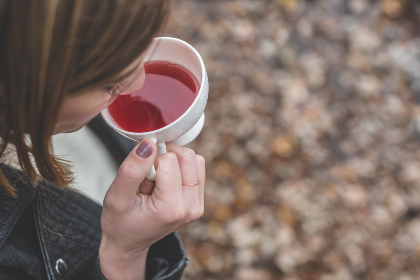 woman,  tea,  drink,  red,  food,  sip,  cup,  mug,  white,  hand,  hold,  person,  people