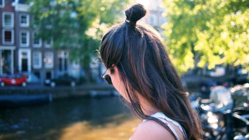 people, woman, bun, green, trees, shades, sunny, urban, city, apartment, building