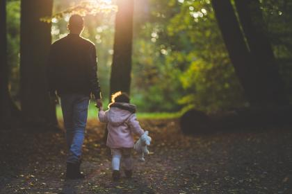 father, daughter, dad, girl, young, family, child, stuffed animal, toy, walking, forest, woods, outdoors, leaves, fall, autumn, nature, people