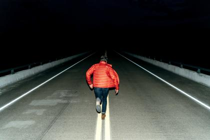 people, man, running, orange, jacket, road, street, empty, dark, night