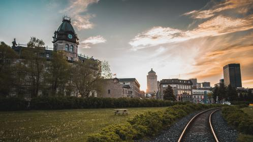 railroad, track, train, green, grass, field, outdoor, trees, plants, nature, sunset, architecture, buildings