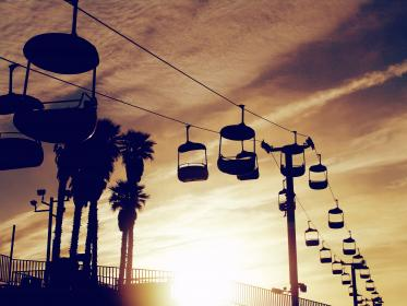 chair lift, cable, sunset, sky, clouds, railing, palm trees, posts
