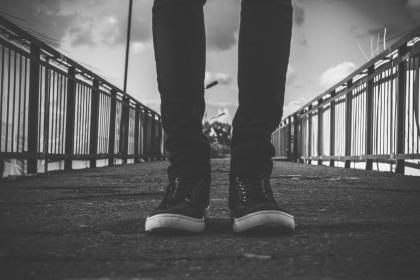black and white, shoe, footwear, travel, skinny, jeans, pants, fence, bridge, structure, clouds, sky