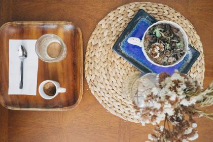 espresso, coffee, drink, beverage, cup, glass, tray, wood, table, napkin, spoon, plant, vase, placemat