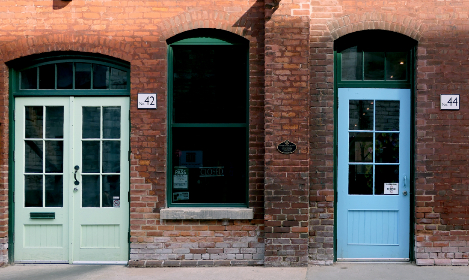 brick,  building,  door,  exterior,  wall,  entrance,  city,  street,  windows,  arch,  urban,  neighborhood,  old,  store,  architecture