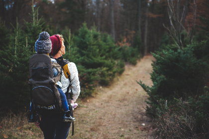 backpack,  woman,  child,  carry,  hike,  park,  forest,  trail,  tree,  bush,  shrub,  green,  hat,  cold,  walk