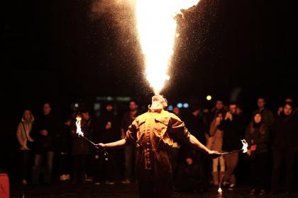 people, men, dancer, dancing, fire, flame, heat, firedance, skill, dark, night, light, crowd, women, event, performance