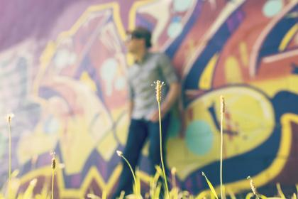 graffiti, mural, spray paint, guy, pants, shirt, sunglasses, fedora, hat, flowers