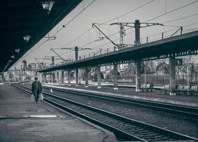railway, railroad, train tracks, transportation, people, walking, pedestrian, train station, city, urban, black and white