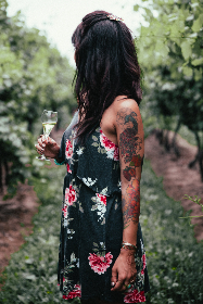 woman,  wine,  vineyard,  female,  lady,  person,  nature,  outdoors,  plants,  vegetation,  farm,  harvest,  drink,  alcohol,  taste,  summer,  glass,  enjoying,  leisure,  standing,  tattoo,  holding,  refreshment,  relaxing