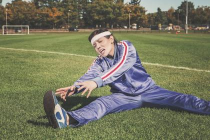 stretching, tracksuit, track and field, sports, athlete, fitness, shoes, headband, grass, field