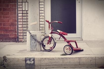 white, door, brick, red, tricycle, lock, chain, wheels, sidewalk, bike