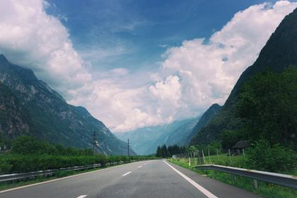 road, highway, railing, blue, sky, clouds, mountains, travel, power lines, driving, hills