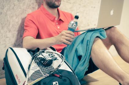 guy, man, squash, racket, sports, athlete, towel, macbook, laptop, computer, gatorade, drink, tired, people, beard, business, fitness, exercise, health