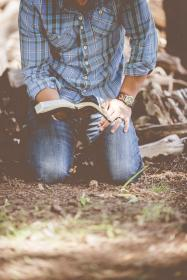 guy, man, male, people, kneel, bust, torso, read, book, fashion, style, ground, dirt, grass, wood, timber, still, bokeh