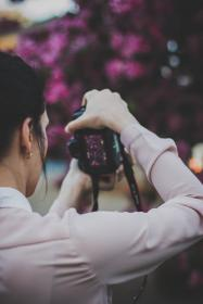 people, girl, woman, alone, fashion, clothing, nature, plant, outdoor, flowers, petal, bokeh, blur, camera, photographer, smile, happy, travel