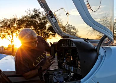 people, old, man, working, aircraft, cockpit, trees, plant, sunset, sunrise, sky, clouds
