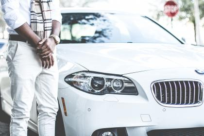 man, standing, guy, car, white, headlight, bumper, windshield, stop, park street, scarf, watch, bmw