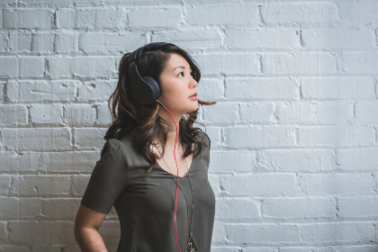 woman,  listening,  music,  headphones,  sound,  listen,  fashion,  style,  person,  people,  brink,  wall