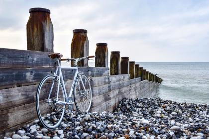 sea, ocean, water, wave, rocks, stone, coast, shore, beach, bike, bicycle, wooden, fence, wood, horizon, sky