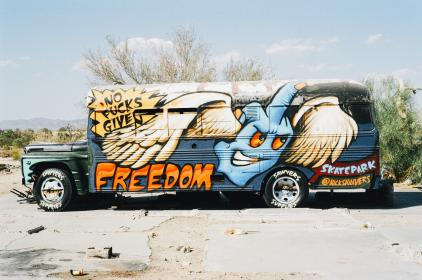bus, graffiti, paint job, middle finger, rebellious, sand